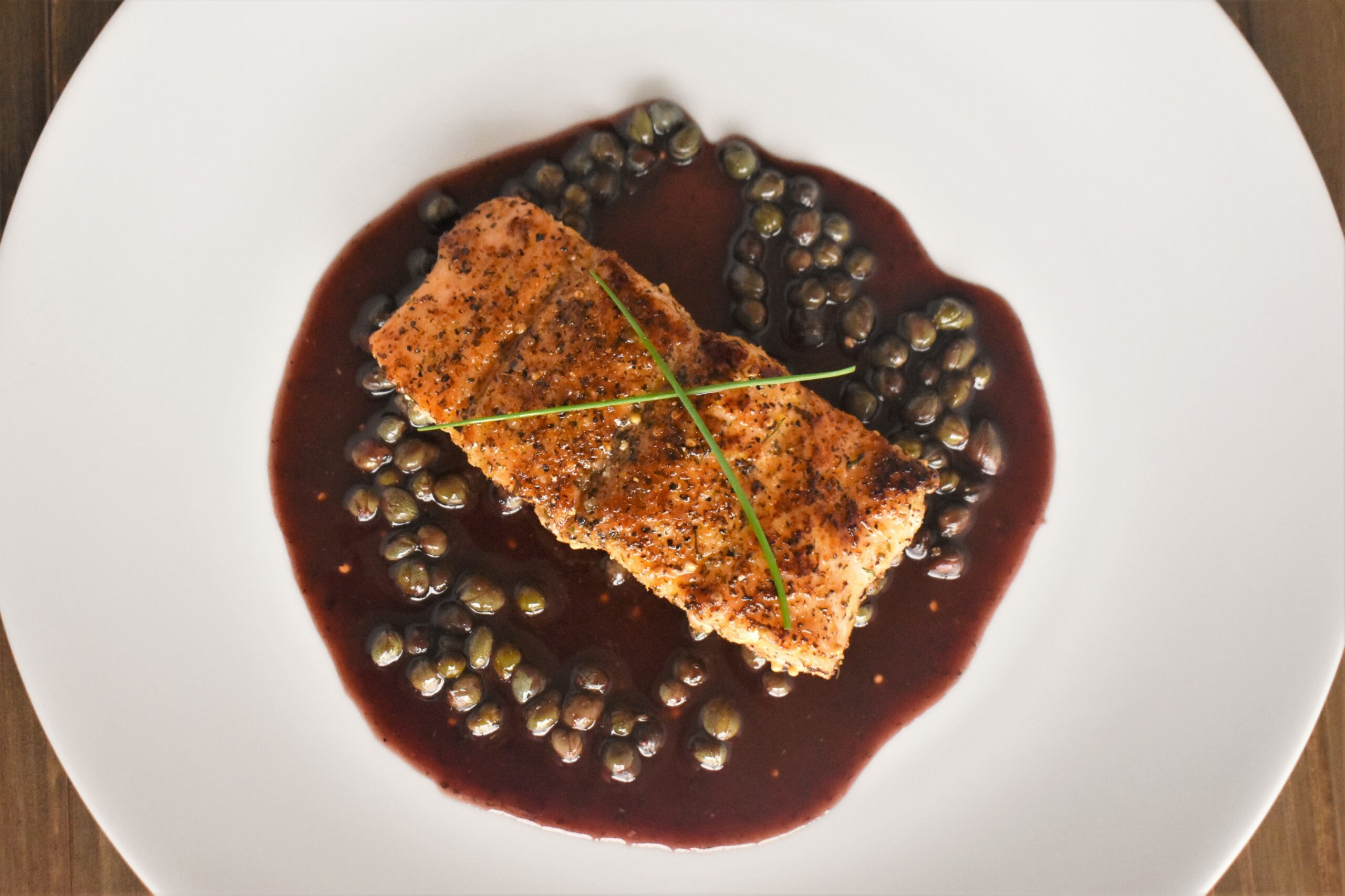 Bronzed Salmon with Merlot Caper Sauce